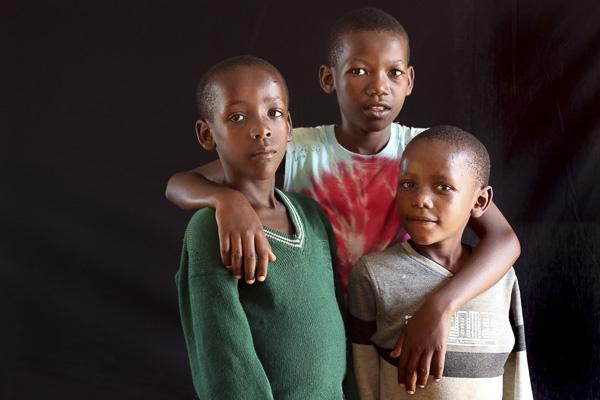Portrait of three brothers by Joseph Korerimana