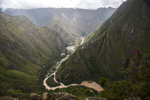 Machu Pichu is surrounded on three sides by the Urubamba River with cliffs dropping vertically almost 1,500 ft.  The Urubamba accounts for the morning mists which rise up from its waters.