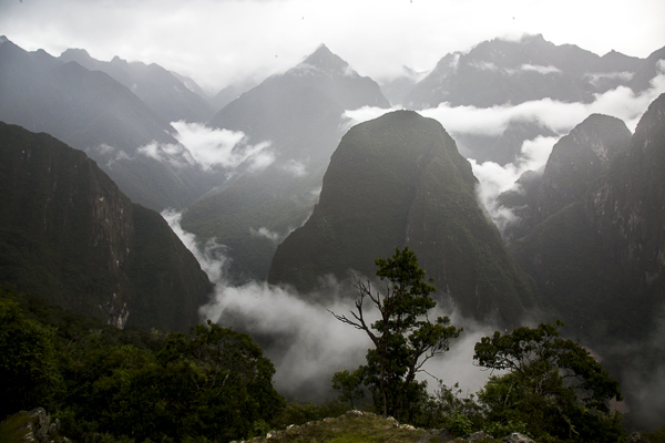 A view of the shrouded Andean mountains surrounding Machu Pichu.