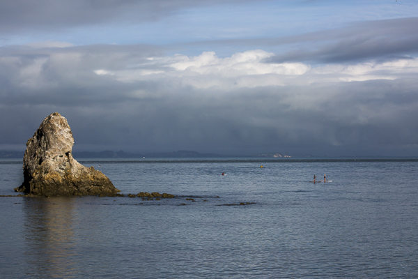 Early morning paddle boarders explore Tasman Bay--best described in shades of blue--in the sweet coastal town of Nelson.