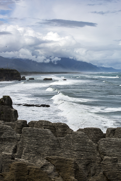 "The west coast's waters, turbulent and unbridled, have worn limestone rocks into strange formations like a pile of pancakes, appropriately nicknamed ""Pancake Rocks""."