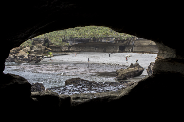 Looking out of a an ocean cave--accessible only at lowtide-- onto one of South Island's more protected west coast beaches.