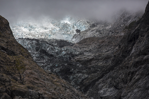 Franz Josef's ice-blue glacial face rises up out of steel-grey rock--a scene so unexpectedly after one emerges from the nearby rainforest hike.