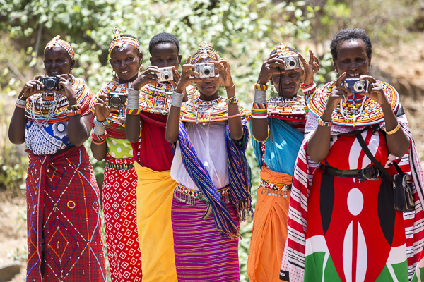 Some of my Samburu workshop women practice photographing after our first training session.