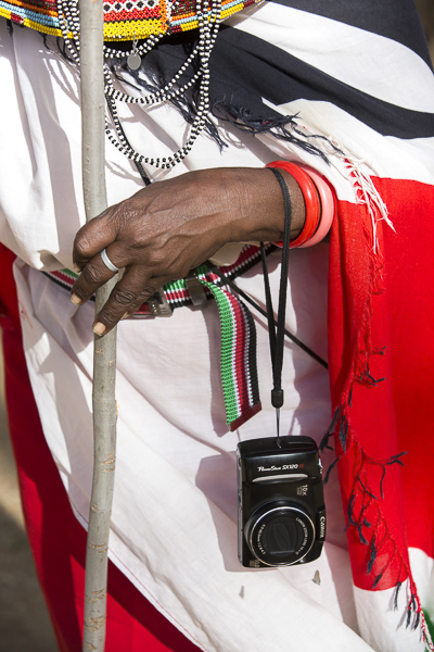 Maria Letiwe, one of the most enthusiastic of the elder women, proudly dons her camera during the workshop.