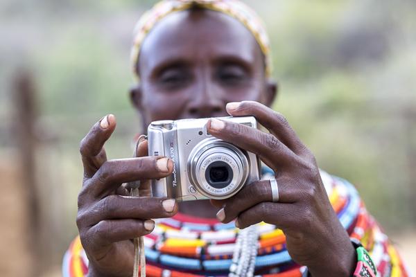Mampayun Lemartili practices using her camera.