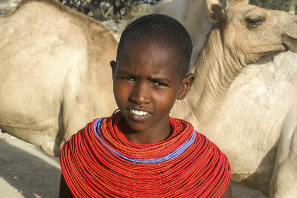 A portrait Mampayun Lemartili made of her daughter in their village. This image not only shows the beads that all young Samburu girls but also how central camels are in the culture--something probably might know.
