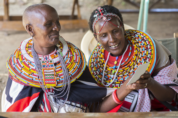 Elder workshop attendees, Joice Lampate and Maria Letiwe, look at one of their prints from the workshop.